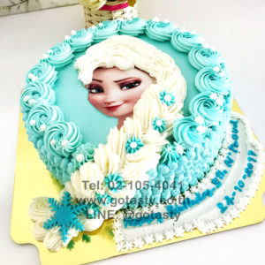 Blue and white photo cake cream hair of princess Elsa from Frozen with snow decoration