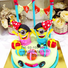 Blue and Yellow 3d fondant cake of Minion from The Walt Disney gift and flag decorations