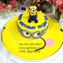 Yellow fondant cake of Minion from The Walt Disney