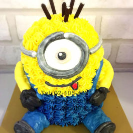 Blue and Yellow 3d cream cake of Minion from The Walt Disney