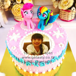 Pink and white 3d cream photo cake of Pony from My little Pony with snow decorations