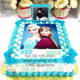 เค้กรูปภาพสีฟ้าและสีขาวเจ้าหญิงเอลซ่าแอนนาจากเรื่องโฟเซ่นตกแต่งหิมะและโบว์