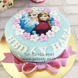 Blue  photo cake of princess Elsa and Anna from Frozen with bow and snow decorations