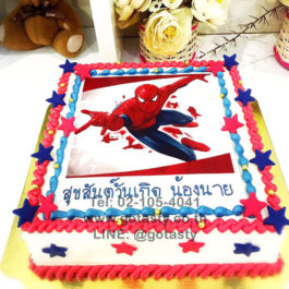 White blue and red photo cake of super hero Spider man from Marvel with star decorations