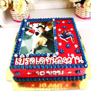 Blue and red photo cake of super hero Spider man from Marvel with snow decorations