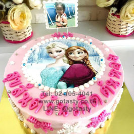 White and pink photo cake of princess Elsa and Anna from Frozen with snow decorations