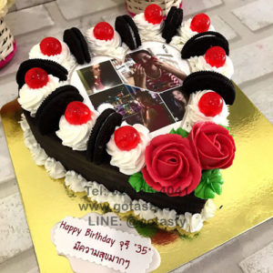 Chocolate white cream photo cake with jelly, rose and Oreo decorations