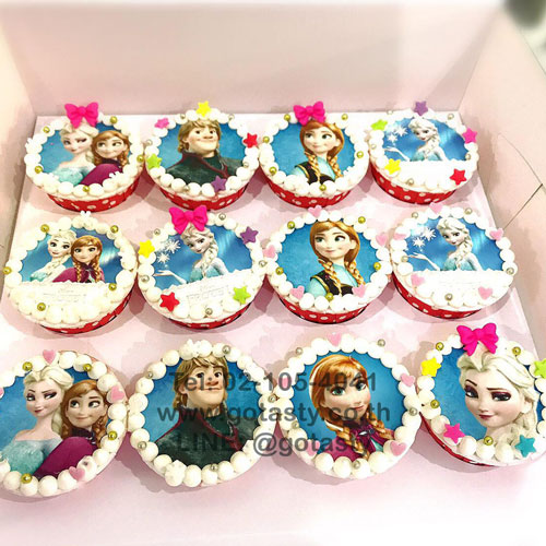 White photo cupcake of Elsa and Anna from Frozen with star and bow decorations