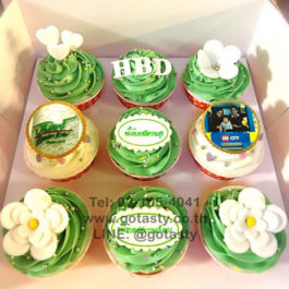 Green photo cupcake with flower and heart decorations
