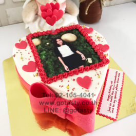 Red and white cream photo cake with heart and bow decorations