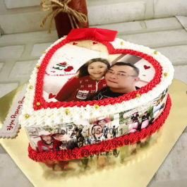 Red and white cream photo cake with bow decorations