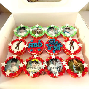 Red and green cupcake photo of boy and Iron man from Marvel with star decorations