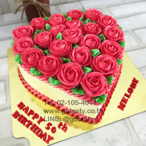 Red and white cream cake with rose decorations