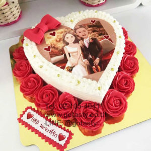 Red and white cream photo cake with rose and bow decorations