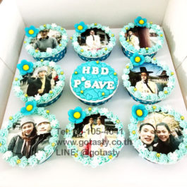 Blue photo cupcake with flower decorations