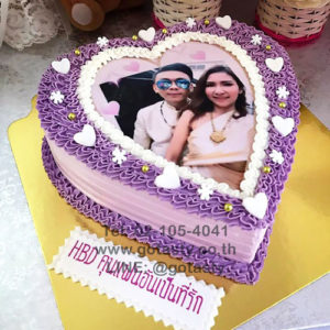 Purple cream photo cake with snow and heart decorations