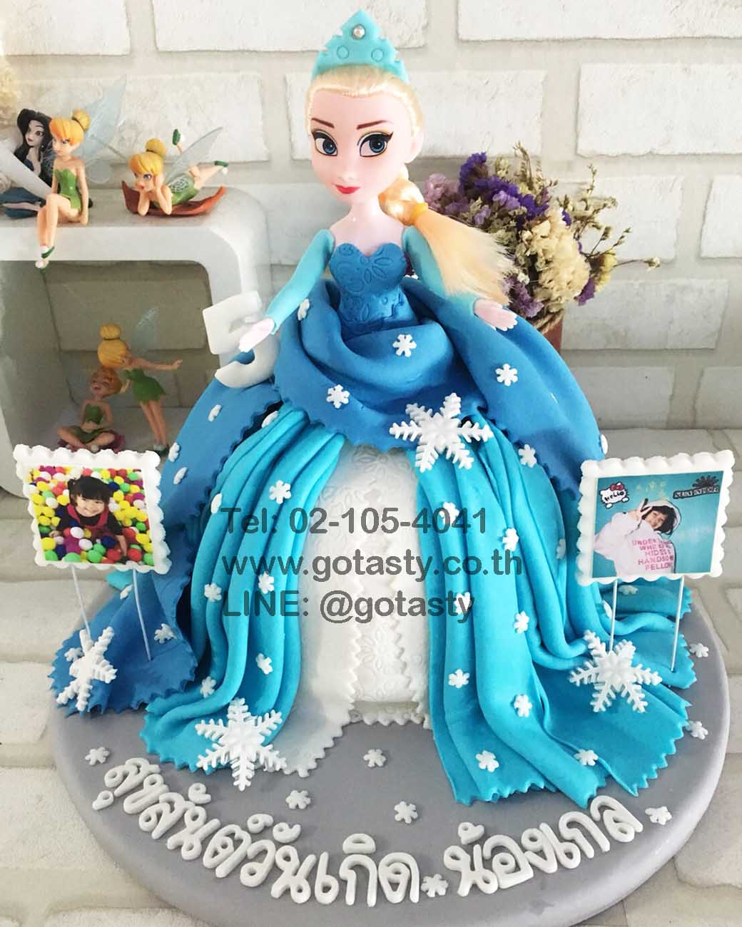 Elsa doll blue dress birthday cake
